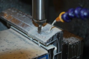 Using a ball endmill and stepping over to cut the top radius.